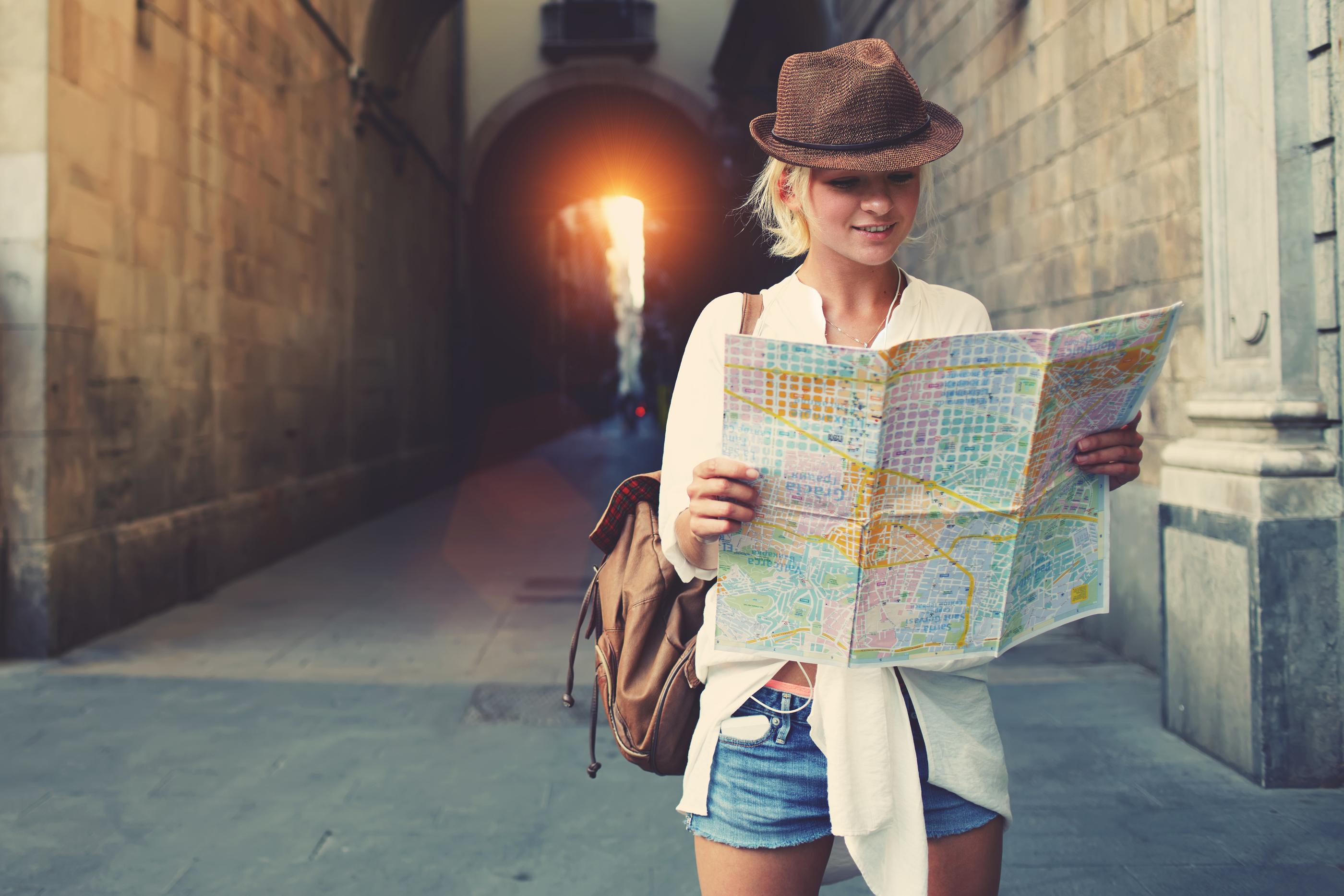 Treating Depression - Happy female traveler
